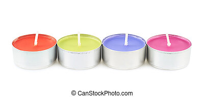 Row of four tea light candles isolated over the white...