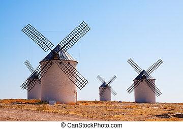 Group of retro windmills in field. La Mancha, Spain