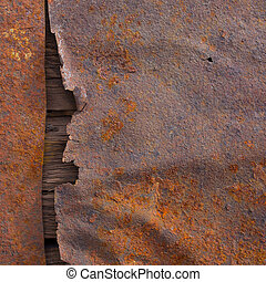 Old rusted metal surface texture with wood