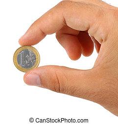 Holding one euro coin - holding one euro coin isolated on...