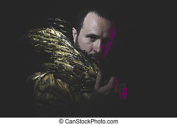 Fantasy, man beard and suit made with golden wings