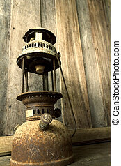 Old lamp - Old-fashioned lamp in an antique rustic country...