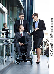 Disabled worker and his co-workers