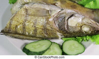 Sudak steamed - Laid on lettuce leaves boiled fish framed...