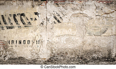 hundred years old advertising on a grungy wall, for...