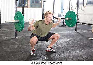 Squat workout at fitness gym center - Weight training at the...