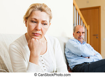 Family conflict - Sad man and woman during quarrel in room...