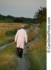 Agronomist after hard work - Tired old agronomist in white...
