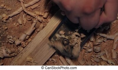 Carpenters plane and shaving on a wooden planks Slow motion...