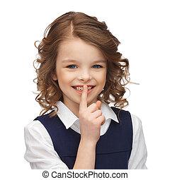 pre-teen girl showing hush gesture - happy children and...