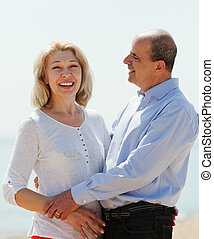 happy mature couple against sea