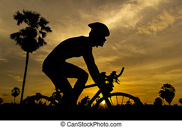Cycling on sunset time in Thailand triathlon