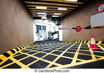 Parking garage underground interior of yellow zebra crossing