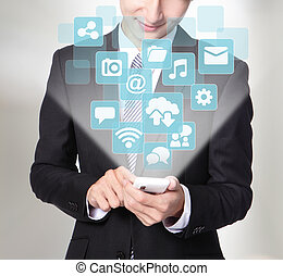 Social media concept - Business man using smart phone with...