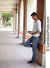 Happy Student man using touch pad - Happy Student man...