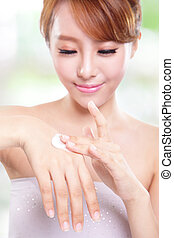 woman applying hand cream - close up of female woman hands...