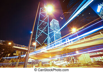 Road light trails on modern city buildings backgrounds in...