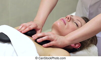 Stone Therapy - Woman enjoying stone therapy