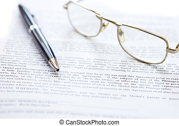 Close-up of document, eyeglasses and pen. - Light: a...