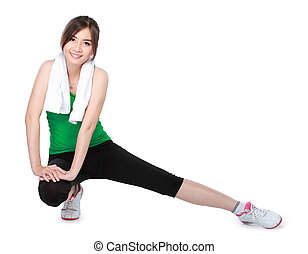 young sport woman stretching - portrait sport woman sitting...