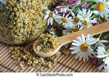 Dried Camomile - Glass jar with dried camomile near wooden...
