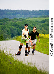 rollerblades for two - a couple ride rollerblades in the...