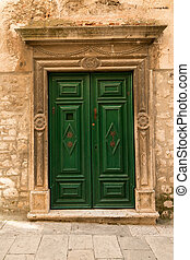 Ancient door - Beautiful old green wooden in historic...