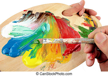 Artist palette , colors and paintbrush close up image