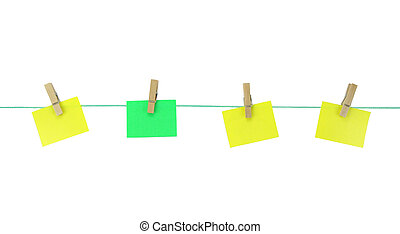 Blank note papers hanging with wood pegs on clothesline on...