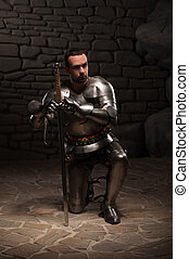Medieval knight kneeling with sword - Medieval knight...