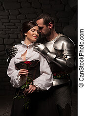 Knight giving a rose to lady - Full length portrait of a...