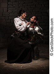 Knight giving a rose to lady - Full length portrait of...
