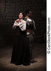 Medieval knight and lady posing - Beautiful couple in...