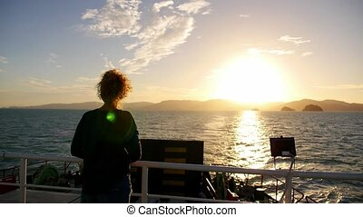 Young Curly Woman Enjoying Beautiful Sunset from the Ferry. Amazing Seascape. Slow Motion.