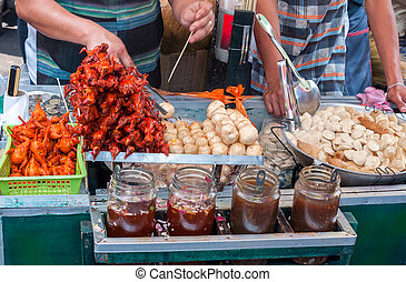 Ducklings on skewers and fish flour balls at a philippine...