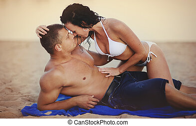 Heterosexual Couple kissing on the beach