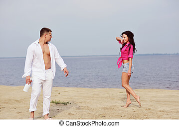 Smiling Young woman flirting with her boyfriend