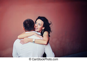 young woman embracing her boyfriend - Close-up of a young...