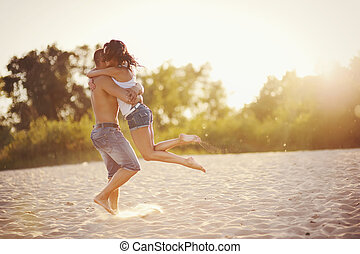 Heterosexual Couple - sweet couple on the beach during...