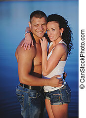 Heterosexual Couple in the sea, posing