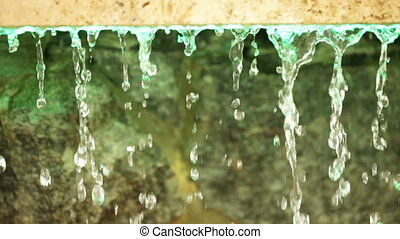 Drained water - Drops of water flowing down from granite...