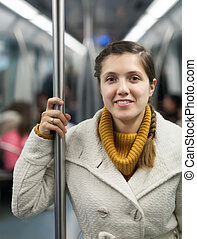 girl passanger standing inside train - Photo of young girl...