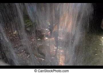 Through the waterfall - Looking through a waterfall at the...