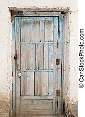 old wooden door on a white wall