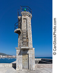 Stone Lighthouse over blue sky - Old small stone lighthouse...