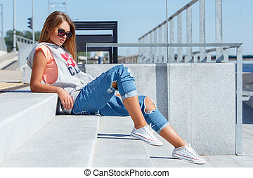 Beautiful girl in sunglasses - Outdoor, street. Attractive...