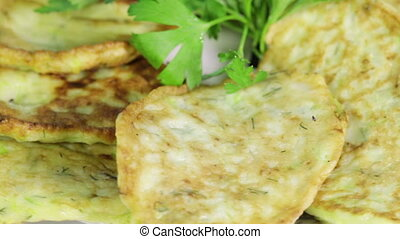Pancakes - Rotating fritters decorated with parsley