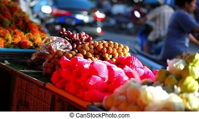 Exotic fruits for sale in the street Asian market. Video...