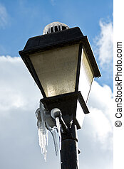 Frozen Street Light - A street light in winter covered with...
