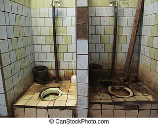 Muddy WC - WC in the old factory in Moscow Russia taken on...